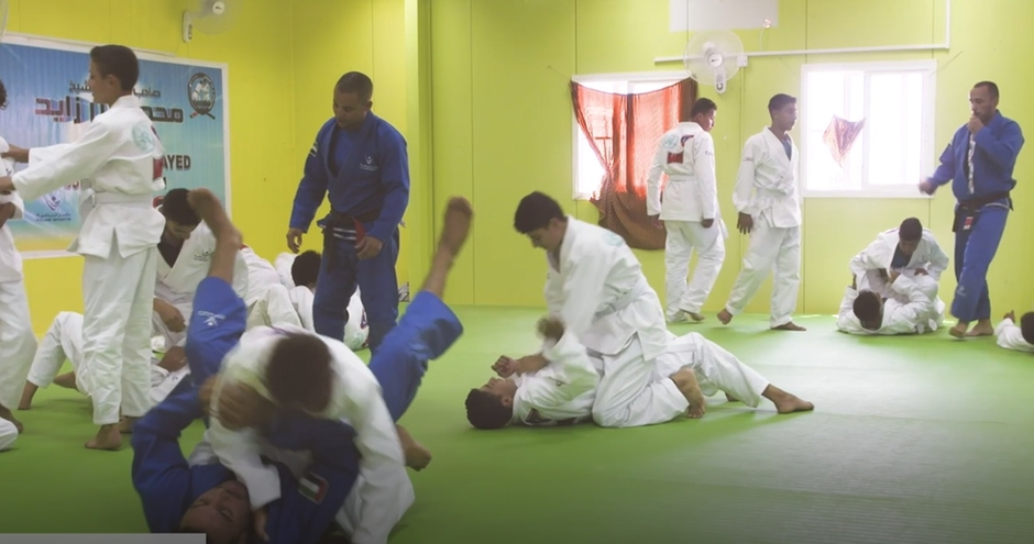 Jiu jitsu students are put through their paces at the refugee camp